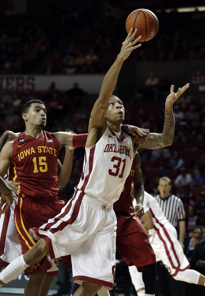 Photo - Oklahoma Sooner's D.J. Bennett (31) shoots and is fouled by Iowa State Cyclone's Naz Long (15) as the University of Oklahoma Sooners (OU) men defeat the Iowa State Cyclones (ISU) 87-82 in NCAA, college basketball at The Lloyd Noble Center on Saturday, Jan. 11, 2014  in Norman, Okla. Photo by Steve Sisney, The Oklahoman