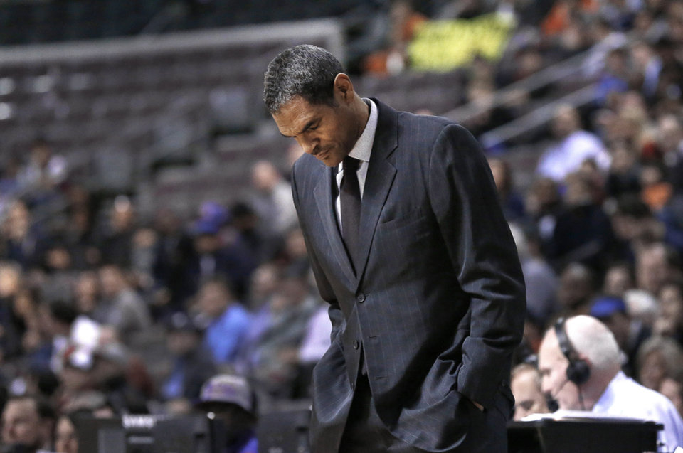 Photo - FILE - In this Dec. 10, 2013 file photo, Detroit Pistons head coach Maurice Cheeks looks down at the floor during an NBA basketball game in Auburn Hills, Mich. Detroit fired Cheeks on Sunday, Feb. 9, 2014, after less than a year as coach, with the Pistons languishing well below .500 despite offseason moves aimed at putting the struggling franchise back in contention. (AP Photo/Paul Sancya, File)
