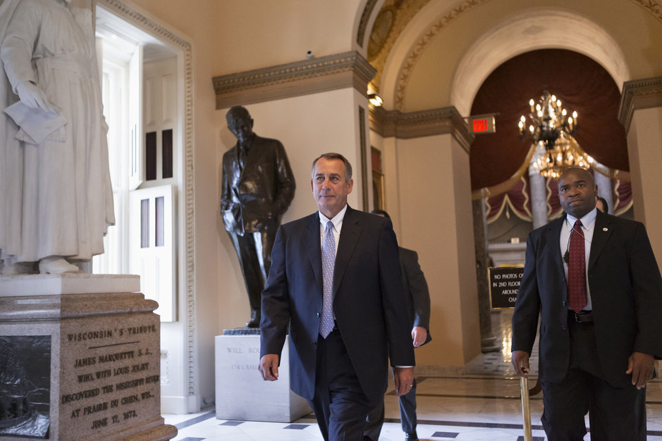 Photo - House Speaker John Boehner of Ohio walks to the floor of the House on Capitol Hill in Washington, Friday, Sept. 27, 2013, as Congress continues to struggle over how to fund the government and prevent a possible shutdown.   (AP Photo/J. Scott Applewhite)