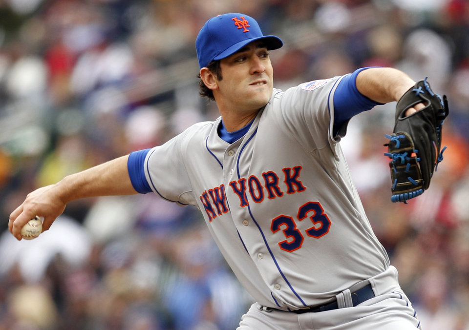 Photo - New York Mets starting pitcher Matt Harvey throws against the Minnesota Twins during the first inning of a baseball game Saturday, April 13, 2013, in Minneapolis. (AP Photo/Genevieve Ross)