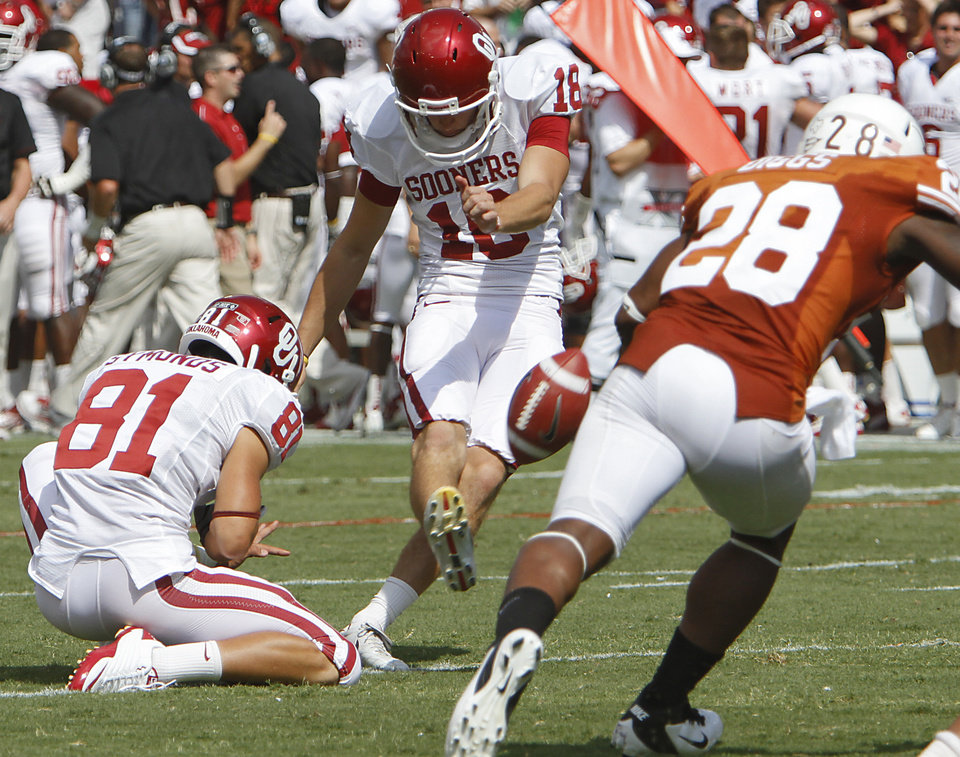Photo - Oklahoma's Michael Hunnicutt (18) kicks a field goal during the Red River Rivalry college football game between the University of Oklahoma Sooners (OU) and the University of Texas Longhorns (UT) at the Cotton Bowl in Dallas, Saturday, Oct. 8, 2011. Photo by Chris Landsberger, The Oklahoman