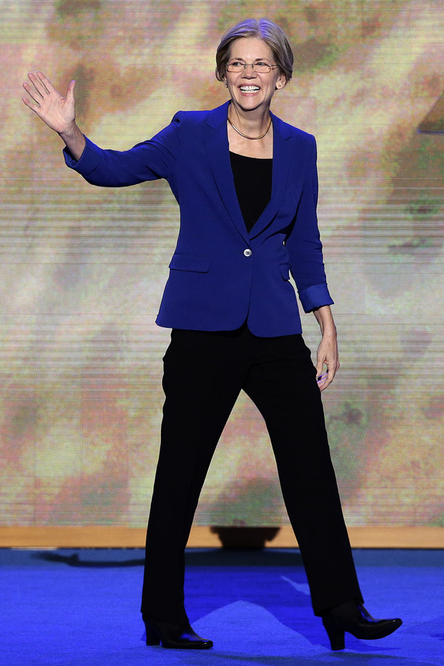 Photo - Senate candidate from Massachusetts Elizabeth Warren waves as she arrives to speak at the Democratic National Convention in Charlotte, N.C., on Wednesday, Sept. 5, 2012. (AP Photo/J. Scott Applewhite)  ORG XMIT: DNC171