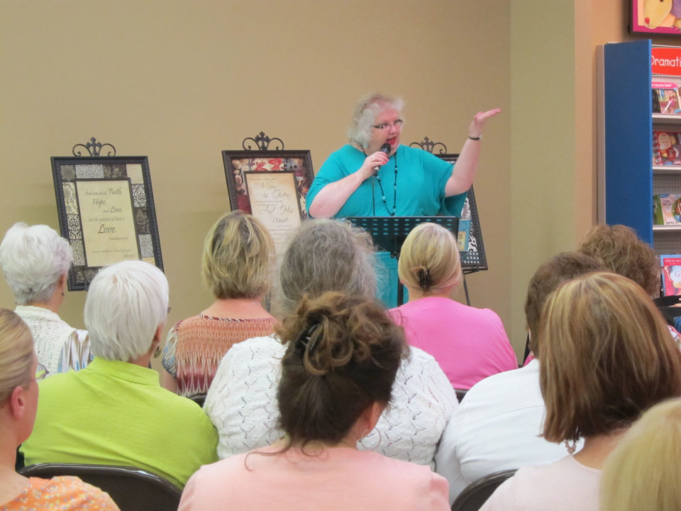 Photo - Author and inspirational speaker Liz Curtis Higgs teaches during a special Bible study based on her book bestselling book