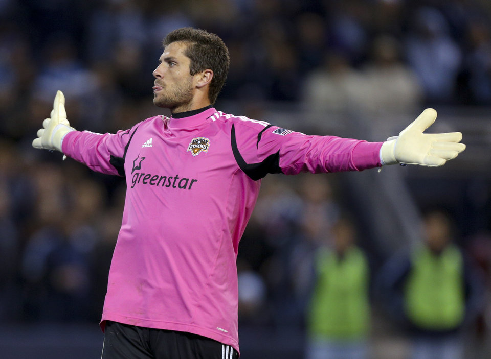 Photo -   Houston Dynamo goalkeeper Tally Hall reacts after a shot on goal was missed by Sporting Kansas City in the second half of an MLS soccer playoff game Wednesday, Nov. 7, 2012, in Kansas City, Kan. (AP Photo/Ed Zurga)