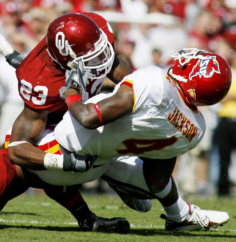 Photo - UNIVERSITY OF OKLAHOMA (OU) VS. IOWA STATE UNIVERSITY (ISU): Iowa State's kick-returner DeAndre Jackson (4) gets tackled by Oklahoma's Allen Patrick (4) in the second quarter of a college football game Saturday, Oct. 14, 2006, in Norman, Okla. Jackson was hurt on the play and did not return. Oklahoma won, 34-9. (AP Photo/Ty Russell) ORG XMIT: OKTR108