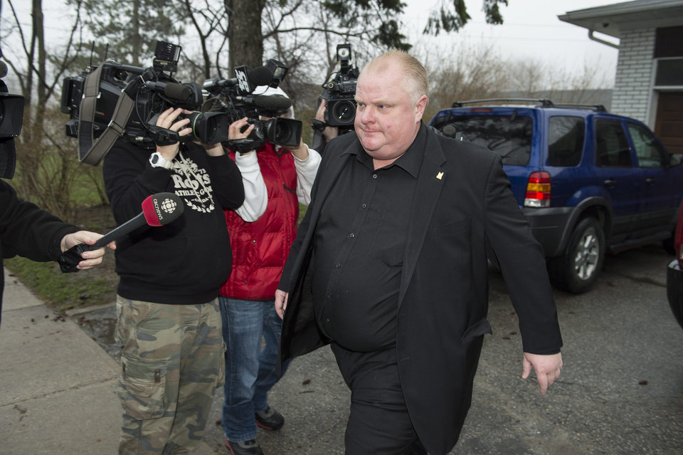 Photo - Toronto Mayor Rob Ford leaves his home early Thursday May 1, 2014, in Toronto. Ford will take an immediate leave of absence to seek help for alcohol, he said, as a report surfaced about a second video of the mayor smoking what appears to be crack cocaine. (AP Photo/The Canadian Press, Frank Gunn)