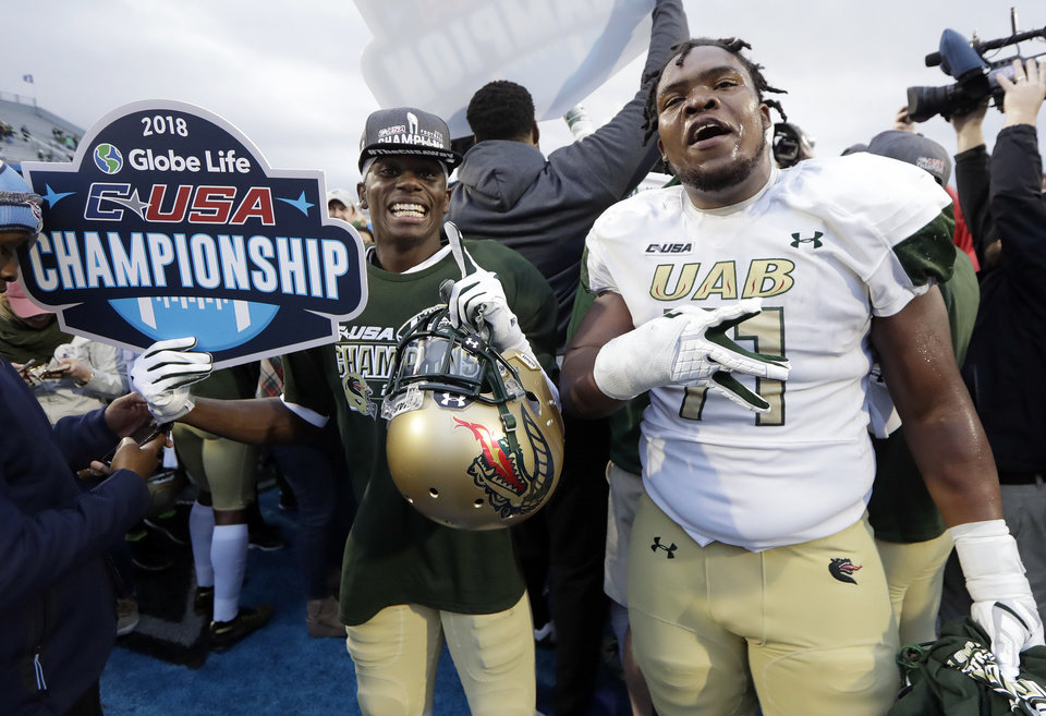 Photo - UAB has been one of college football's best stories, going from the program shuttering to winning the Conference USA championship. [AP PHOTO]