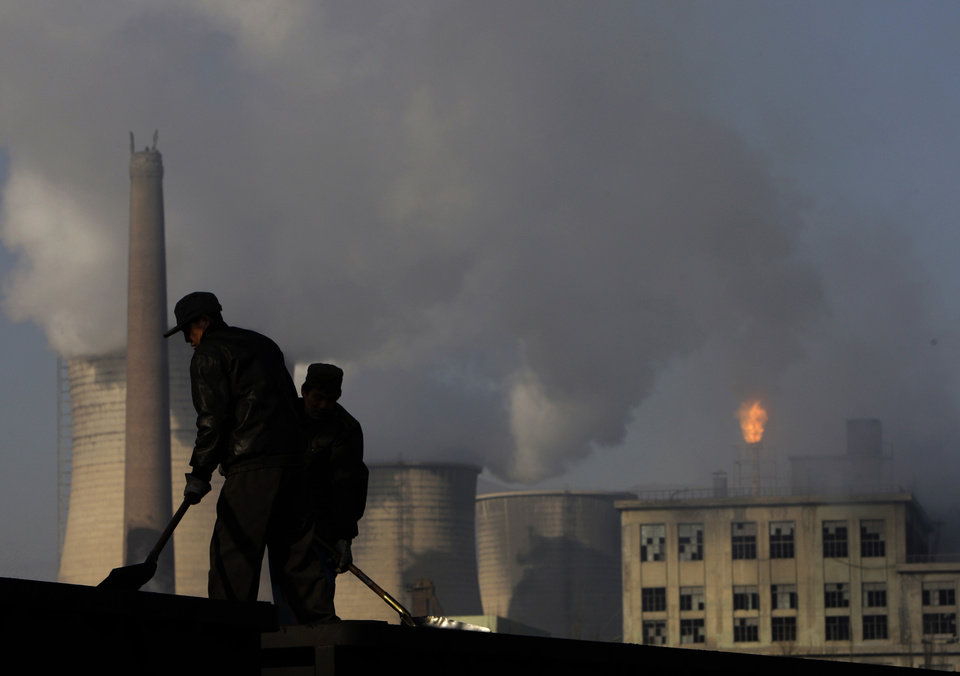 Photo - FILE - In this Nov. 30, 2007 file photo, backdrop by cooling towers of a power plant and chemical factory, miners shovel coal at a mine in Xiahuayuan county, north China's Hebei province. President Barack Obama's proposal to curb U.S. greenhouse gas emissions might improve the chances of completing a global climate treaty but is unlikely to defuse demands by China, India and others for Americans to do more. China, the biggest emitter, has promised to curb its output but with its economy slowing, and communist leaders under pressure to generate jobs, has resisted binding limits. (AP Photo/Oded Balilty, File)