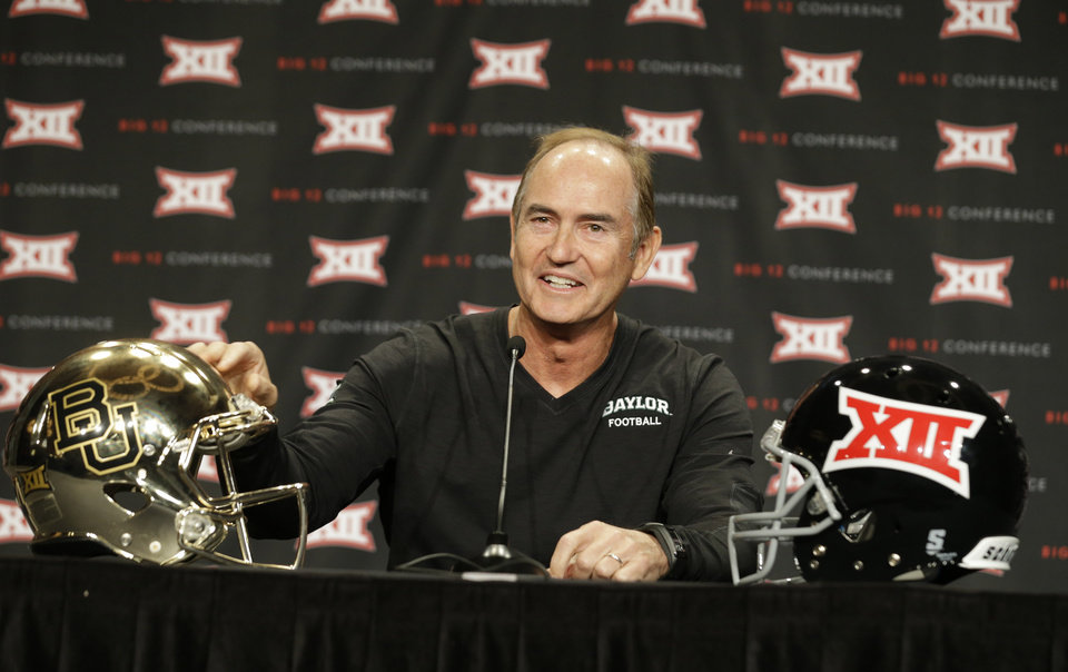 Photo - Baylor head coach Art Briles touches his teams' helmet while speaking to reporters during the NCAA college Big 12 Conference football media days in Dallas, Monday, July 21, 2014. (AP Photo/LM Otero)