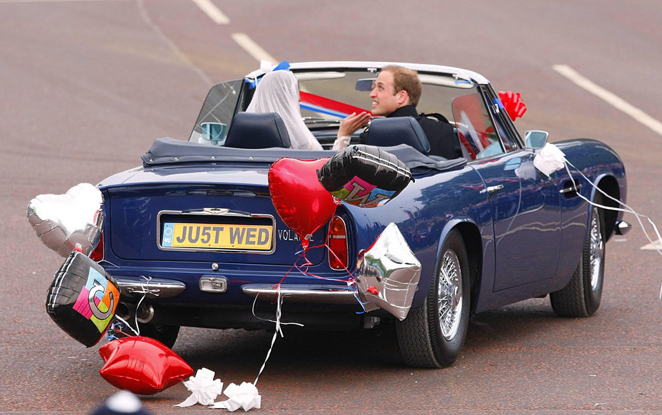 Photo - Britain's Prince William drives himself and his wife Kate. Duchess of Cambridge, as they leave Buckingham Palace for Clarence House, following ineir wedding in London, Friday April 29, 2011. The car is a vintage Aston Martin Volante.(AP Photo/Chris Ison-pa) UNITED KINGDOM OUT: NO SALES: NO ARCHIVE:   ORG XMIT: LON825