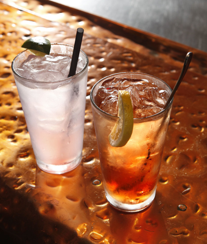 "Photo - A ""Lemongrass Fizz"" and a ""Firefly Ice Pick"" are Iron Starr Urban BBQ drink creations. PHOTO BY PAUL HELLSTERN, THE OKLAHOMAN ARCHIVES"