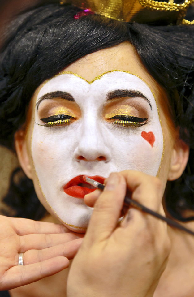 If you want to spend less but make a big impact, makeup can stand alone as a Halloween look. Here, makeup artist Sharon Tabb of The Makeup Room Agency, applies Queen of Hearts makeup to model Clancey. Makeup sold at Party Galaxy. Photo by Chris Landsberger, The Oklahoman. CHRIS LANDSBERGER