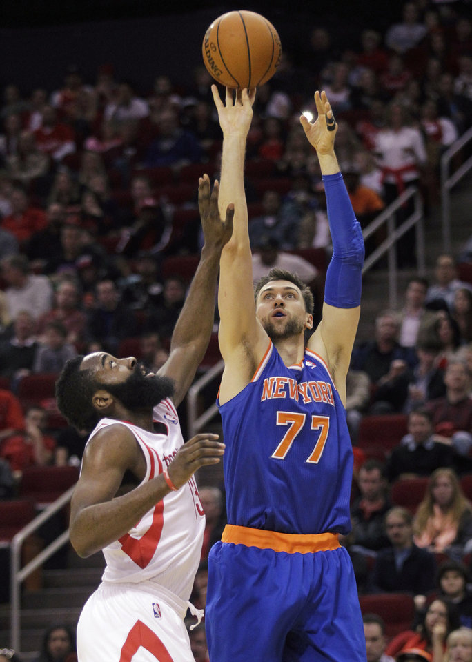 Photo - New York Knicks center Andrea Bargnani (77) shoots over Houston Rockets guard James Harden (12) during the second quarter of an NBA basketball game, Friday, Jan. 3, 2014, in Houston. (AP Photo/Patric Schneider)