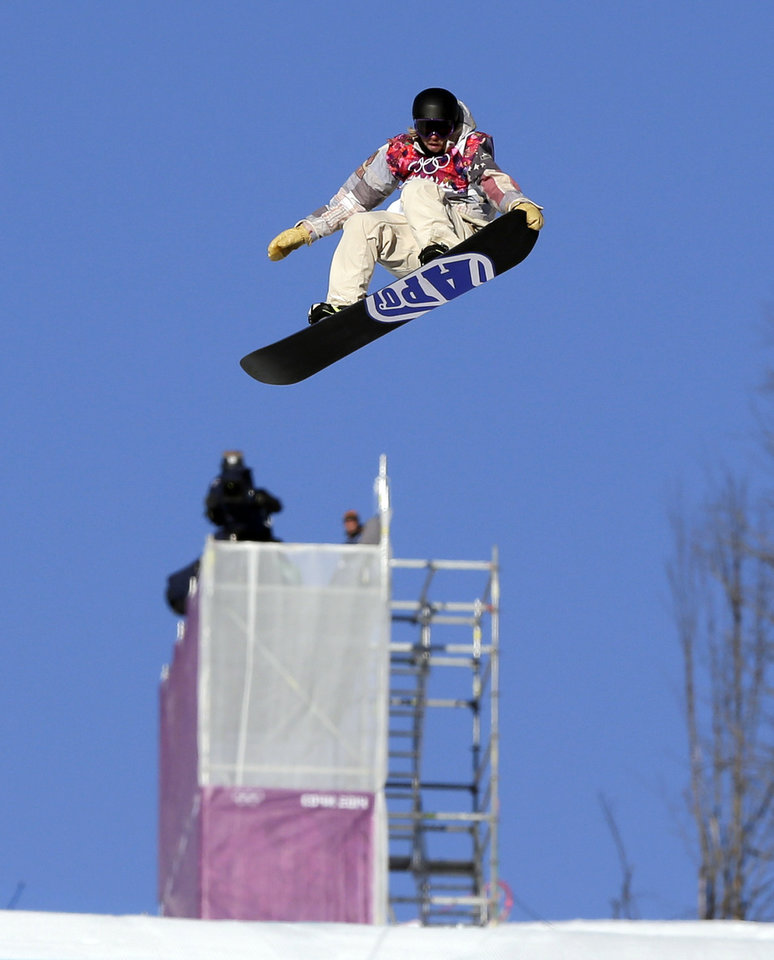 United States' Sage Kotsenburg takes a jump during the men's  snowboard slopestyle semifinal at the Rosa Khutor Extreme Park, at the 2014 Winter Olympics, Saturday, Feb. 8, 2014, in Krasnaya Polyana, Russia. (AP Photo/Andy Wong)