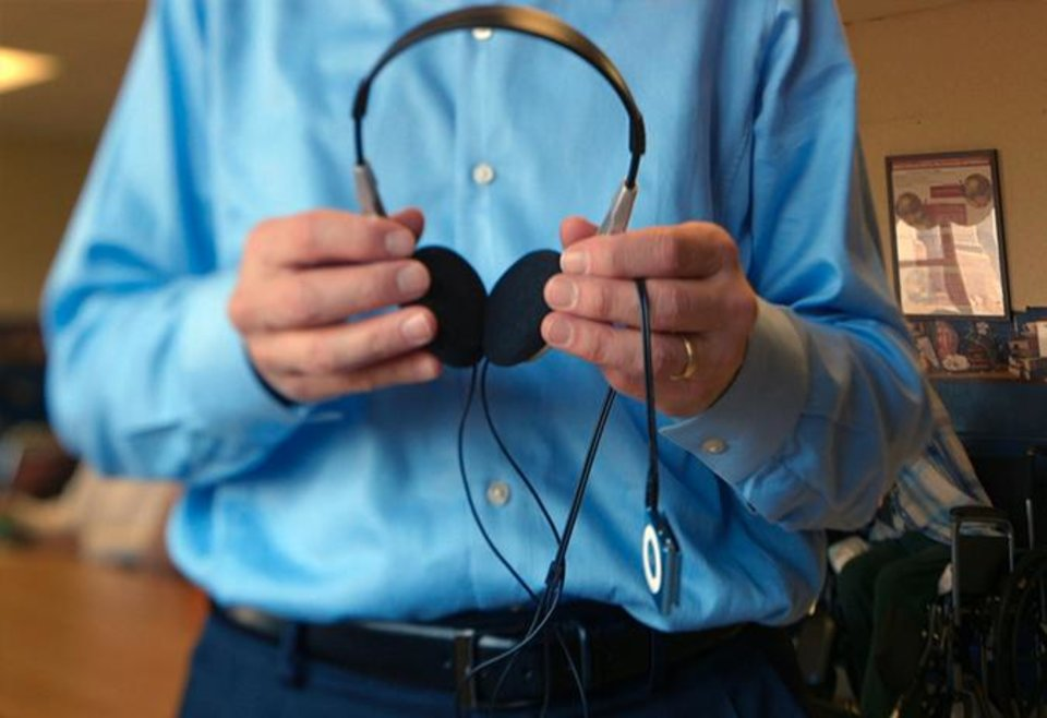 Photo -  Dan Cohen holds a pair of headphones to be given to a memory loss patient. Cohen is founder and executive director for Music & Memory, a nonprofit with a program of music therapy using personalized music lists that stimulate patients with extreme memory loss. Photo provided.