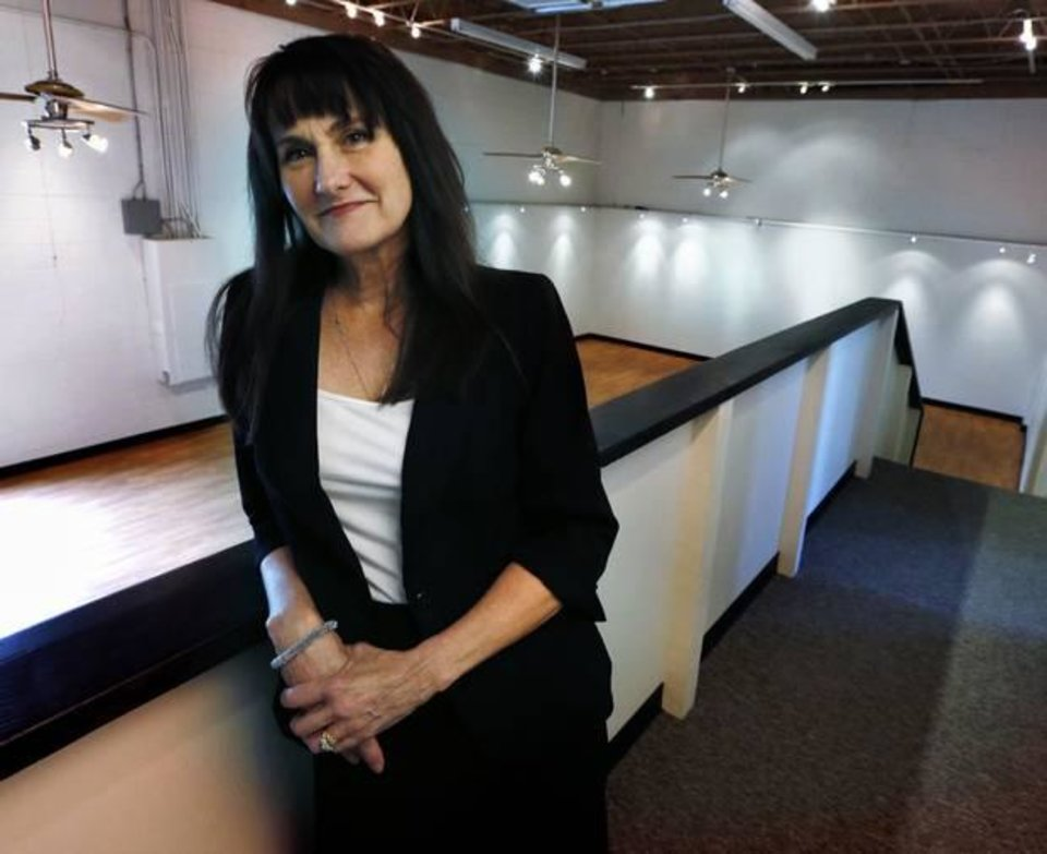 Photo -  Kathryn McGill, director of Shakespeare in the Park, in the new offices for her organization at 2920 Paseo St., on Tuesday, July 29, 2014 in Oklahoma City, Okla. Photo by Steve Sisney, The Oklahoman