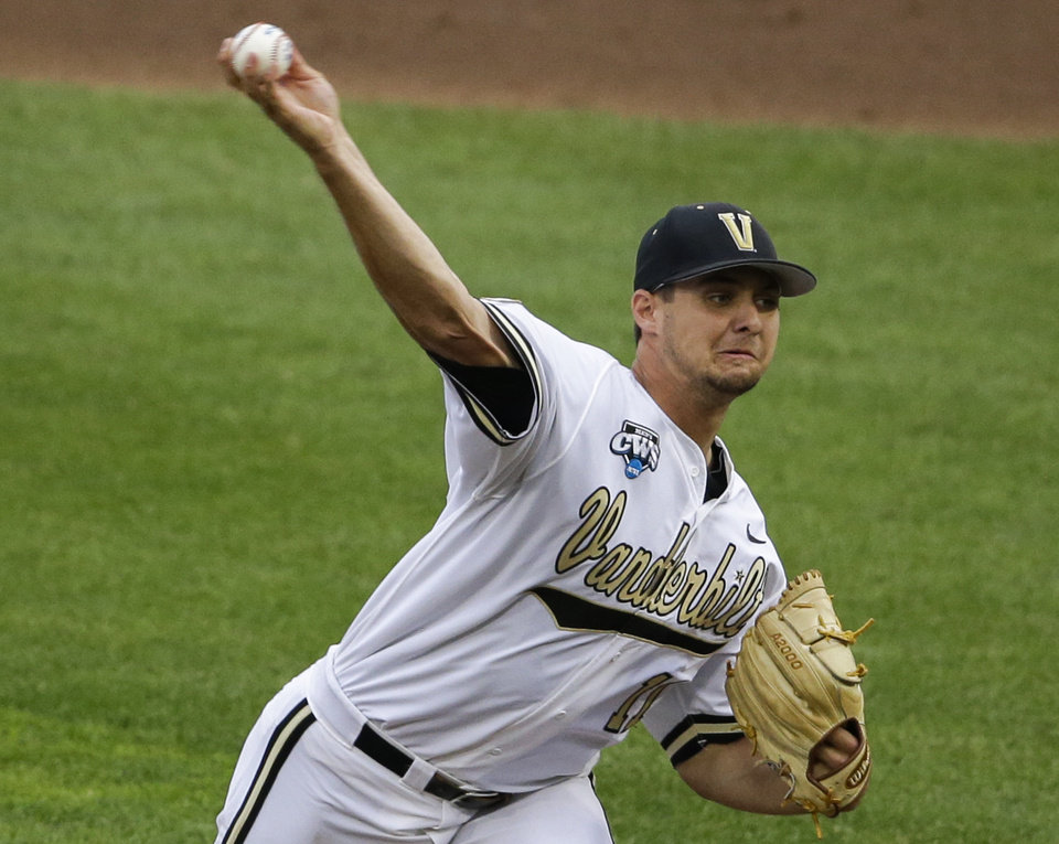 Photo - Vanderbilt pitcher Tyler Beede (11) delivers against UC Irvine in the first inning of an NCAA baseball College World Series game in Omaha, Neb., Monday, June 16, 2014. (AP Photo/Nati Harnik)