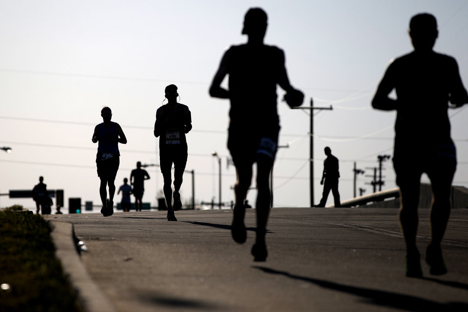 Photo - Runners make their way west on Britton Road towards Lake Hefner during the Oklahoma City Memorial Marathon in Oklahoma City, Sunday, April 29, 2018. Photo by Bryan Terry, The Oklahoman