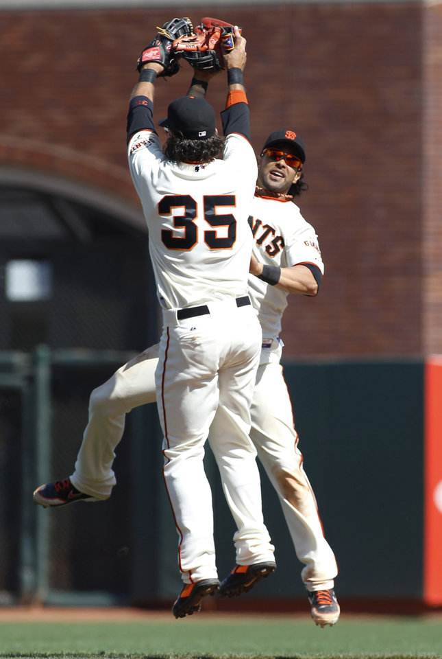 Photo - San Francisco Giants' Brandon Crawford (35) and Angel Pagan celebrate after a baseball game in which the Giants defeated the Chicago Cubs 5-0, Wednesday, May 28, 2014, in San Francisco. (AP Photo/George Nikitin)