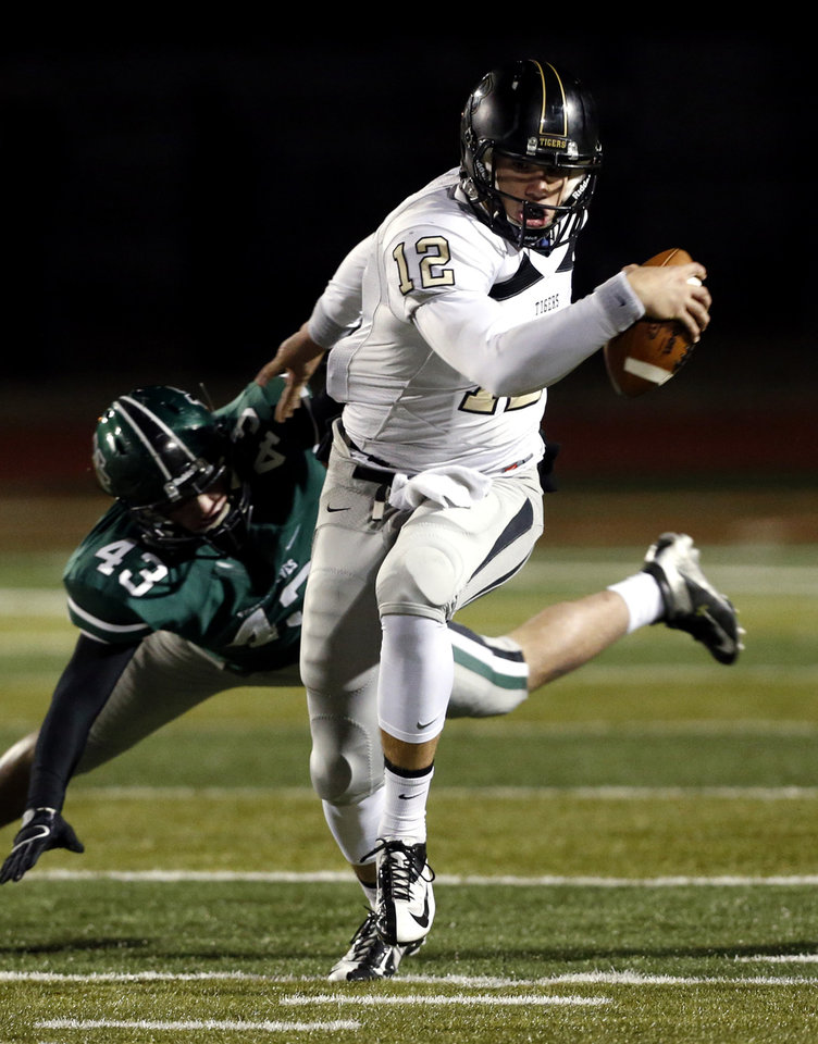 Photo - HIGH SCHOOL FOOTBALL PLAYOFFS: Broken Arrow quarterback Coleman Key runs past Norman North Timberwolves' Kaden McClellan in Class 6A football on Friday, Nov. 16, 2012 in Norman, Okla.  Photo by Steve Sisney, The Oklahoman