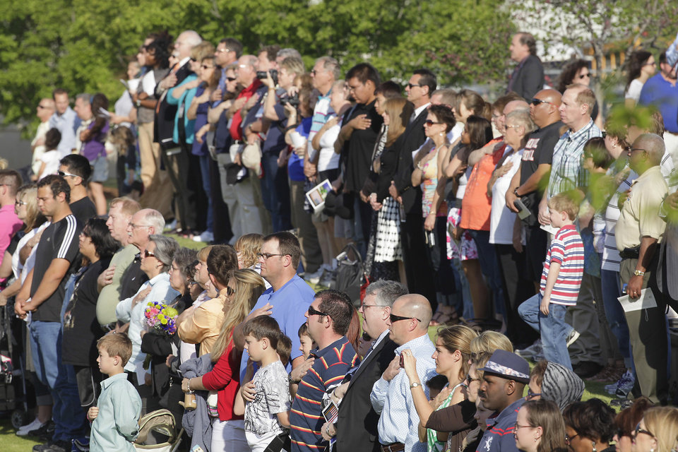 Participant place their hand over their hearts during the playing of the national anthem at the Day of Remembrance Ceremony, Tuesday, April 19, 2011.   This was the 16th annual Oklahoma City Bombing Memorial ceremony.   Photo by David McDaniel, The Oklahoman