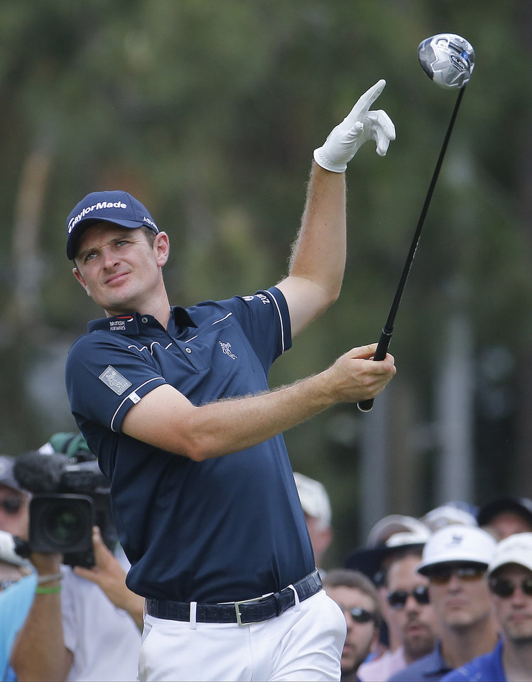 Photo - Justin Rose, of England, reacts to his tee shot on the eighth hole during the first round of the U.S. Open golf tournament in Pinehurst, N.C., Thursday, June 12, 2014. (AP Photo/Matt York)