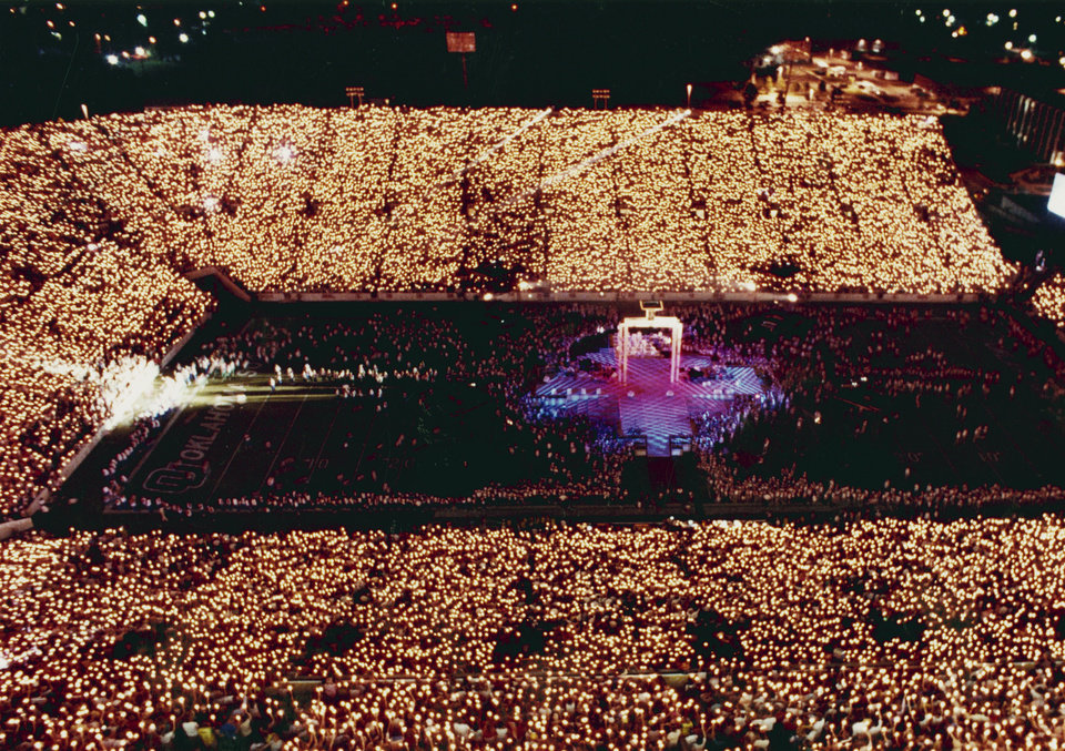 Photo - The more than 75,000 candles held by spectators for the Olympic Festival Opening Ceremonies light up Memorial Stadium on July 21, 1989.  Photo by Steve Gooch