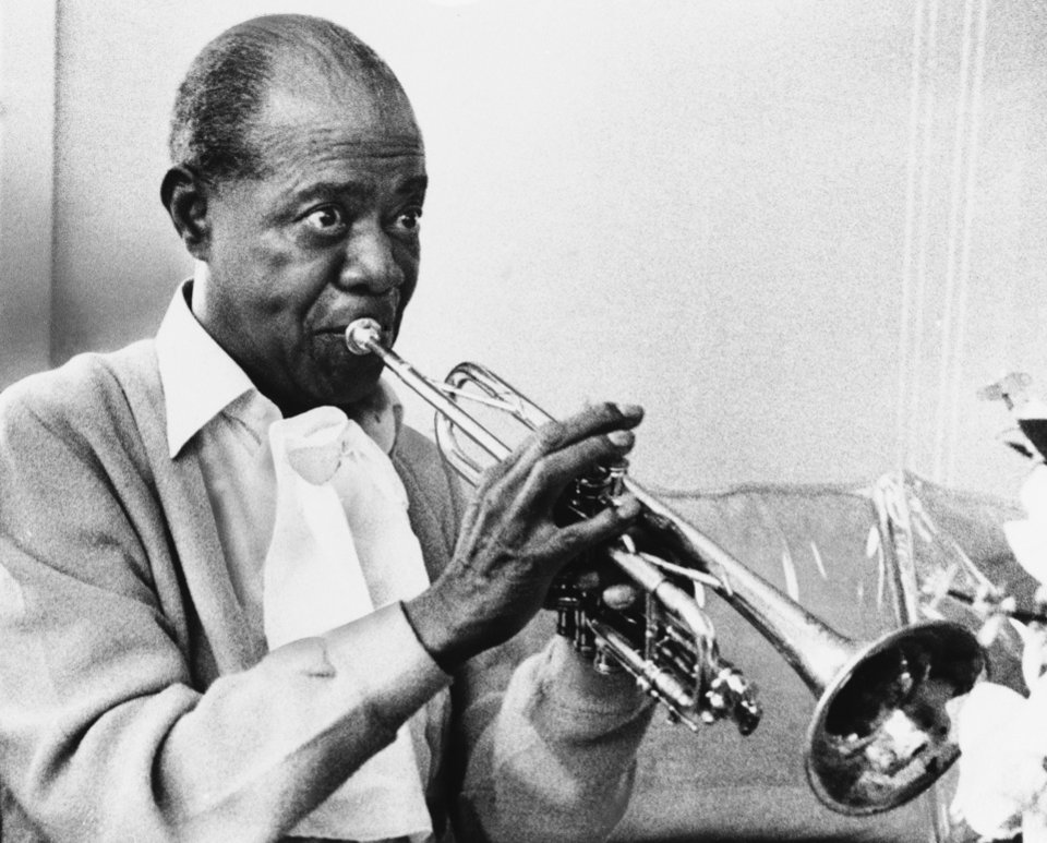FILE -- In a June 21, 1971 file photo jazz great Louis Armstrong practices with his horn at his Corona, New York home on June 21, 1971. A live recording of Louis Armstrong playing his trumpet for one of the last times is being played Friday April 27, 2012 at the National Press Club in Washington where it was created in January 1971. (AP Photo/Eddie Adams, file)