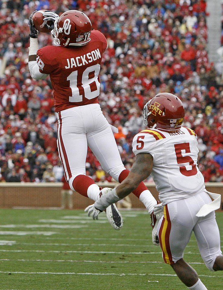 Photo - Oklahoma's Kameel Jackson (18) catches a pass in front of Iowa State's Jeremy Reeves (5) during a college football game between the University of Oklahoma Sooners (OU) and the Iowa State University Cyclones (ISU) at Gaylord Family-Oklahoma Memorial Stadium in Norman, Okla., Saturday, Nov. 26, 2011. Photo by Bryan Terry, The Oklahoman