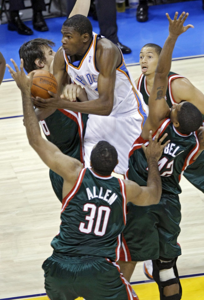 Photo - OKLAHOMA CITY THUNDER / NBA BASKETBALL TEAM / REGULAR SEASON FIRST GAME / OPENING NIGHT: Kevin Durant of the Thunder drives through the Bucks defense during the second half of the opening night NBA basketball game between the Oklahoma City Thunder and the Milwaukee Bucks on Wednesday, Oct. 29, 2008, at the Ford Center in Oklahoma City, Okla.  BY CHRIS LANDSBERGER, THE OKLAHOMAN  ORG XMIT: KOD