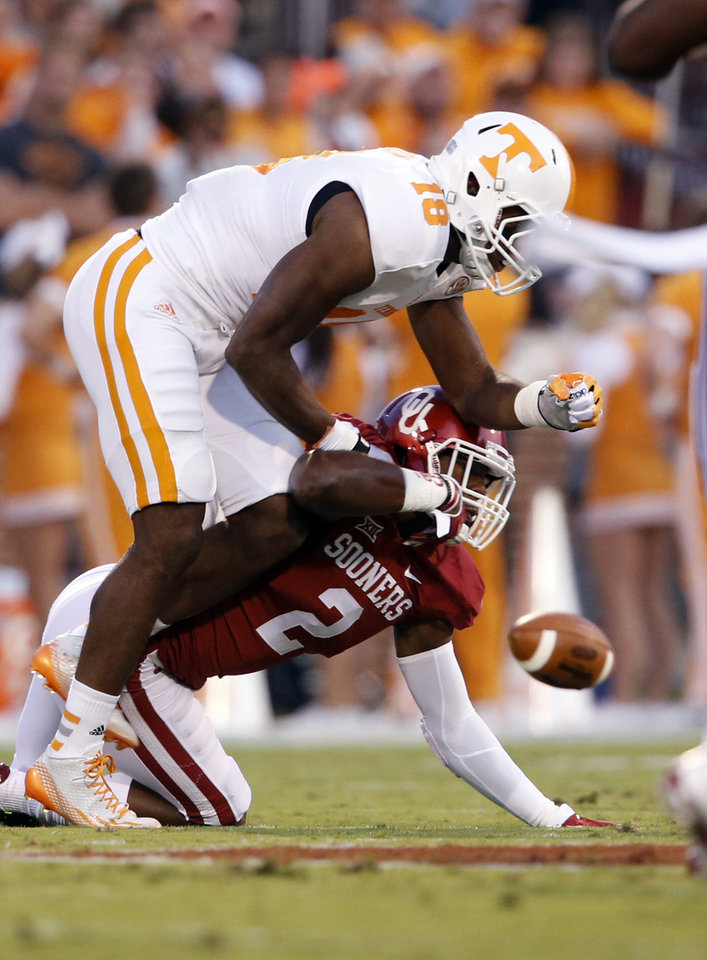 Photo - Oklahoma's Julian Wilson (2) defends on a pass to Tennessee's Jason Croom (18) during a college football game between the University of Oklahoma Sooners (OU) and the Tennessee Volunteers at Gaylord Family-Oklahoma Memorial Stadium in Norman, Okla., on Saturday, Sept. 13, 2014. Photo by Steve Sisney, The Oklahoman