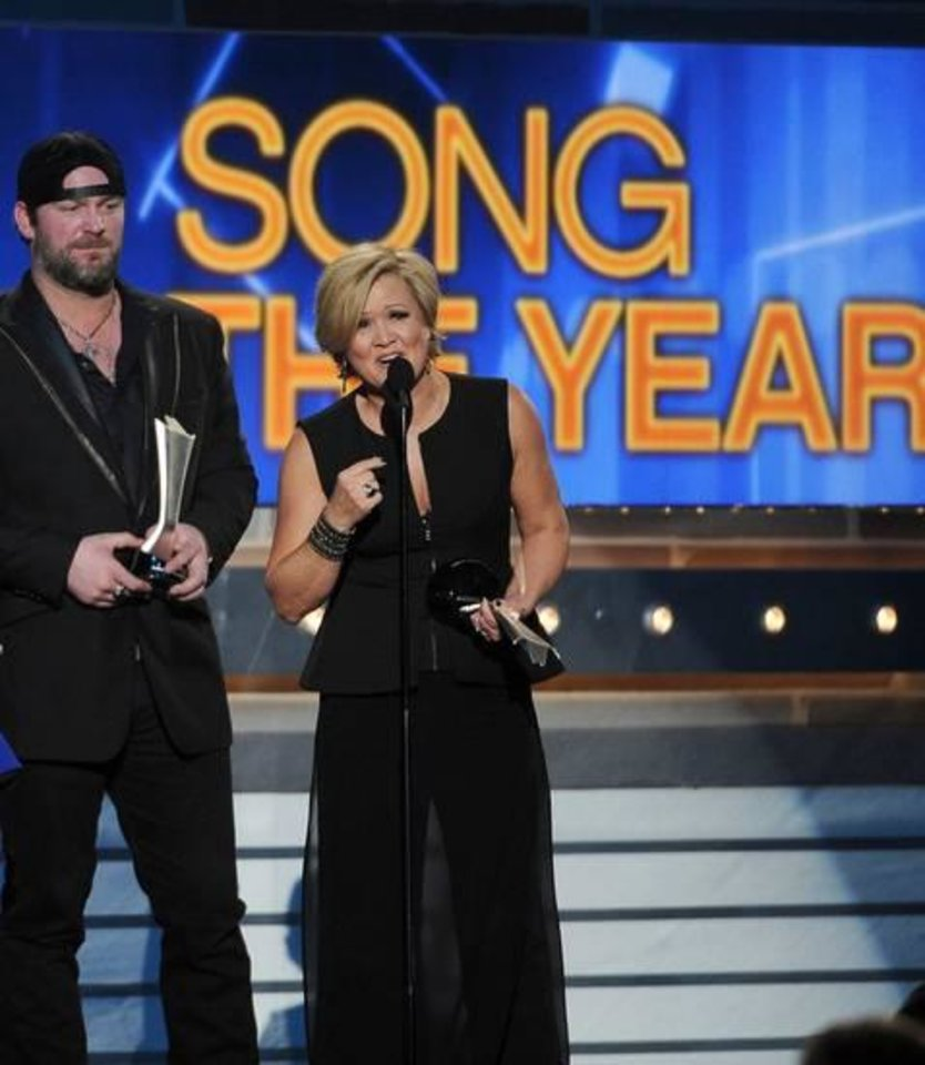 Photo -  Lee Brice, left, and songwriter Connie Harrington accept the award for song of the year at the 49th annual Academy of Country Music Awards at the MGM Grand Garden Arena on Sunday, April 6, 2014, in Las Vegas. (AP)