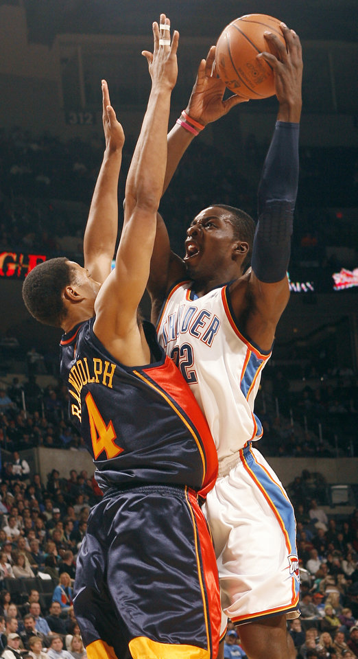Photo - Oklahoma City's Jeff Green (22) puts up a shot over Golden State's Anthony Randolph (4) during the first half of the NBA basketball game between the Oklahoma City Thunder and the Golden State Warriors at the Ford Center on Monday, Dec. 7, 2009, in Oklahoma City, Okla.   Photo by Chris Landsberger, The Oklahoman ORG XMIT: KOD