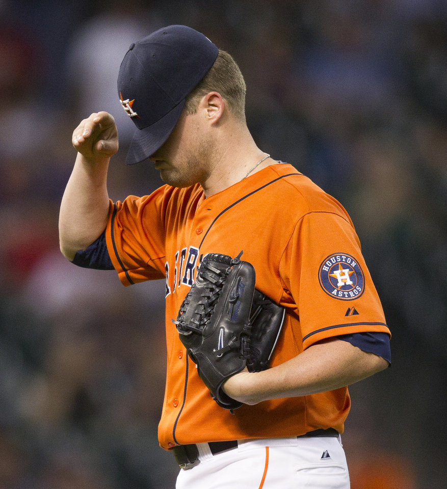 Houston Astros starting pitcher Bud Norris reacts after giving up a two-run home run to Seattle Mariners' Kyle Seager in the fourth inning of baseball game Friday, July 19, 2013, in Houston. (AP Photo/Bob Levey)