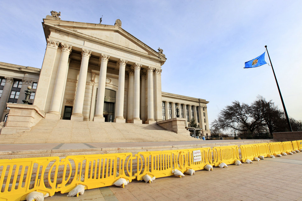 Photo - Barricades erected to protect the public from falling rock and mortar continue to block the south steps of the state Capitol in Oklahoma City. Photo by Paul B. Southerland, The Oklahoman  PAUL B. SOUTHERLAND - PAUL B. SOUTHERLAND