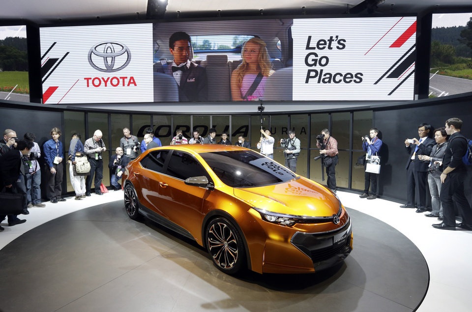 FILE - In this Jan. 14, 2013 file photo, Toyota unveils its Corolla Furia Concept car during the North American International Auto Show in Detroit. Toyota has once again dethroned General Motors as the world's top-selling automaker. The Japanese company sold 9.7 million cars and trucks worldwide in 2012, although it's still counting. GM sold 9.29 million. (AP Photo/Carlos Osorio, File)