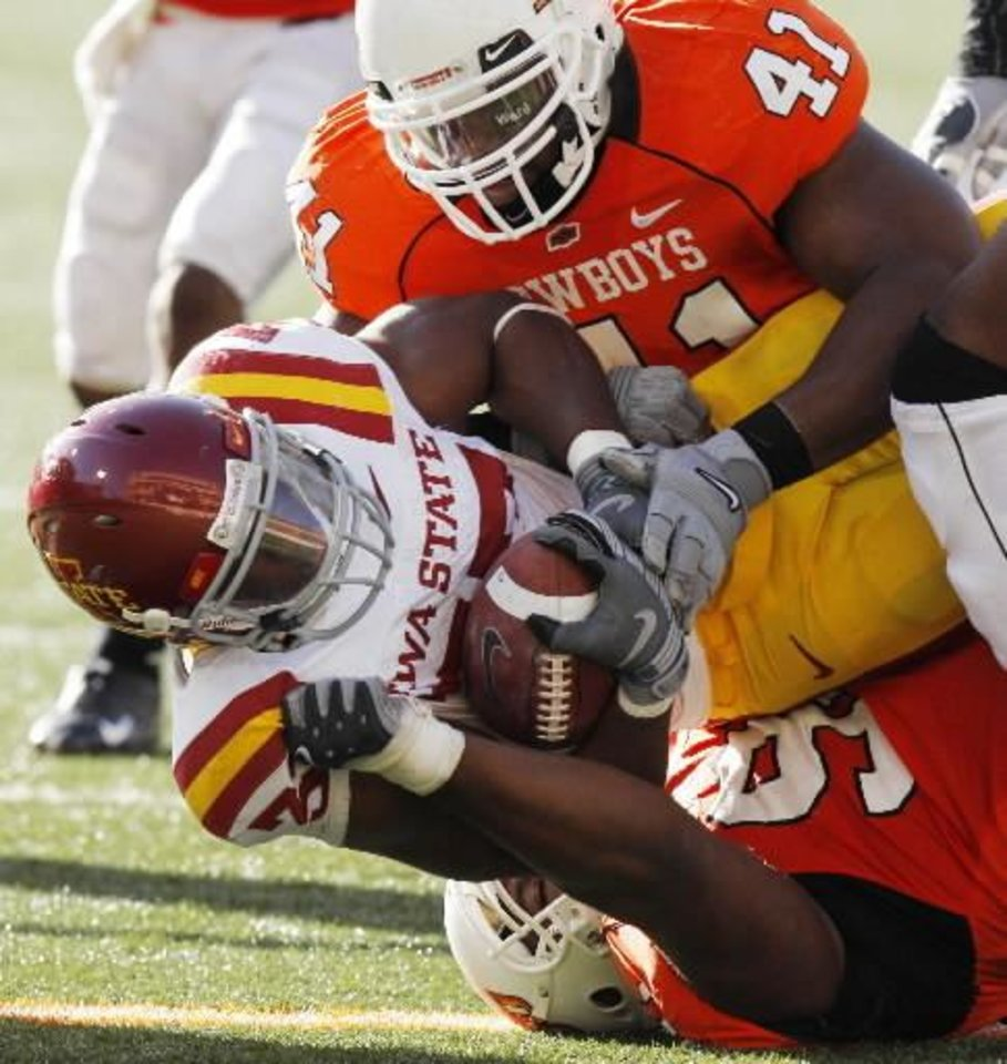 Jeray Chatham brings down Alexander Robinson with the help of Orie Lemon (41) at the Oklahoma State University ( OSU) college  football game against Iowa State University (ISU) at Boone Pickens Stadium in Stillwater, Okla. Saturday November 1, 2008. PHOTO BY DOUG HOKE, THE OKLAHOMAN