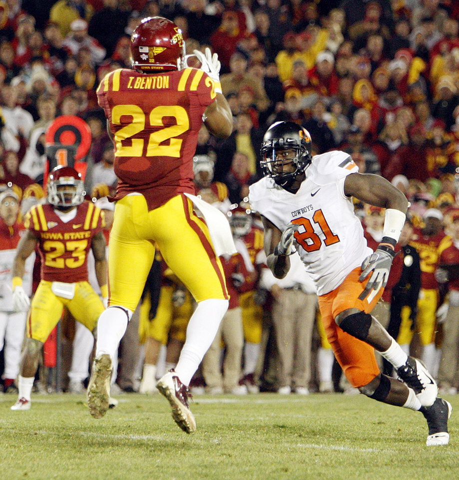 Photo - ISU's Ter'Ran Benton (22) intercepts a pass intended for OSU's Justin Blackmon (81) in double overtime during a college football game between the Oklahoma State University Cowboys (OSU) and the Iowa State University Cyclones (ISU) at Jack Trice Stadium in Ames, Iowa, Friday, Nov. 18, 2011. Iowa State won, 37-31, in double overtime. Photo by Nate Billings, The Oklahoman