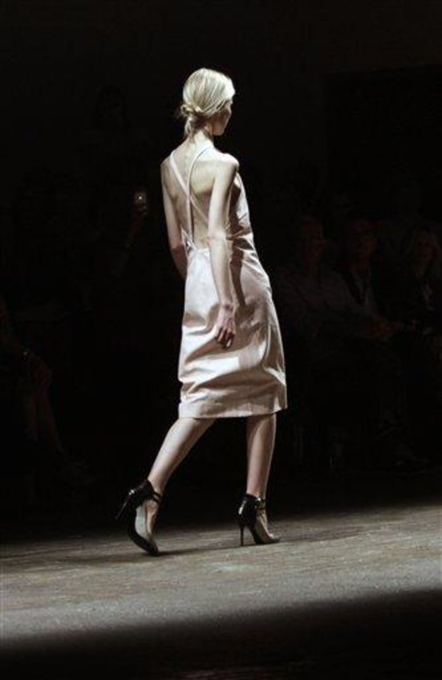 Fashion from the Spring 2013 collection of Yigal Azrouel is modeled on Friday, Sept. 7, 2012 in New York. (AP Photo/Bebeto Matthews)