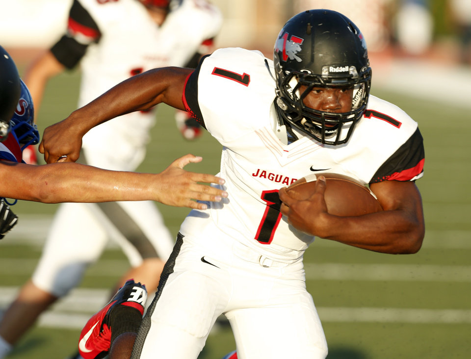 Photo - Westmoore's Kieron Hardrick (1) heads to the end zone for a touchdown in the first half as The Moore Lions play the Westmoore Jaguars in high school football on Friday, Aug. 31, 2012 in Moore, Okla.  Photo by Steve Sisney, The Oklahoman
