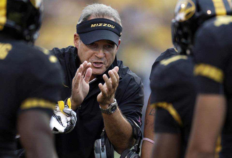 Photo -   FILE- In this Sept.15, 2012, file photo, Missouri head coach Gary Pinkel applauds his team after a score during the first quarter of an NCAA college football game against Arizona State in Columbia, Mo. Nick Saban will have a reunion of sorts from Kent State's 1972 Mid-American Conference championship team, since he couldn't make the first one. The Alabama coach was a safety on that team 40 years ago, while Missouri's Pinkel was the star tight end. They'll be opposing coaches for the first time Saturday in Columbia, Mo., instead of teammates and co-workers. (AP Photo/Jeff Roberson, File)