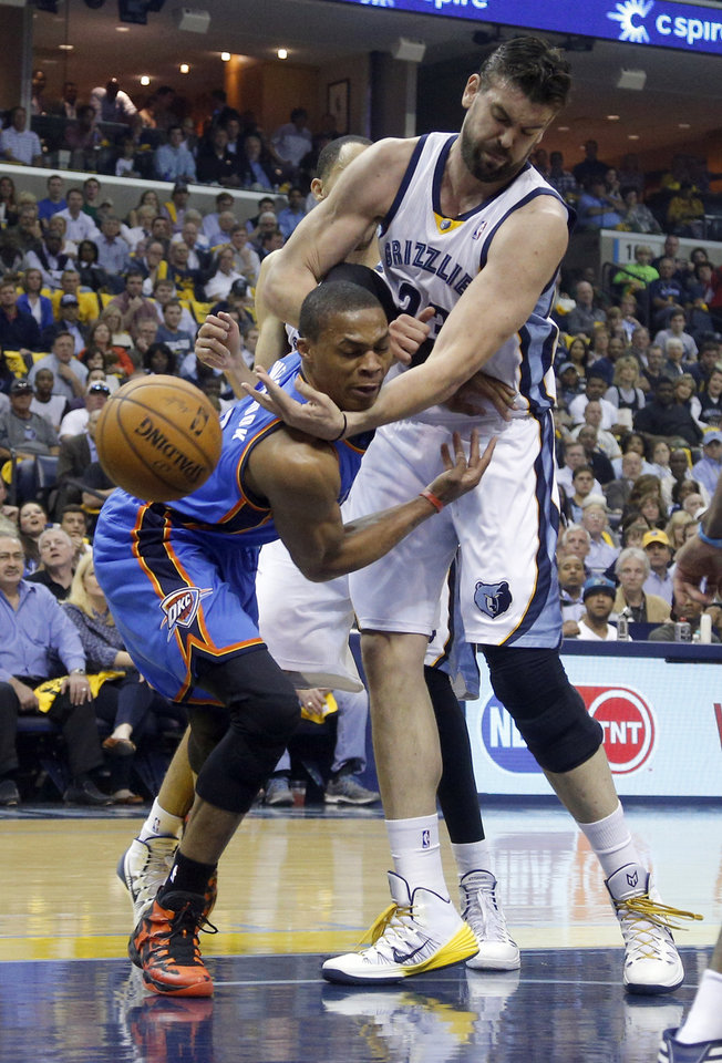 Memphis' Marc Gasol (33) defends against Oklahoma City's Russell Westbrook (0) during Game 6  in the first round of the NBA playoffs between the Oklahoma City Thunder and the Memphis Grizzlies at FedExForum in Memphis, Tenn., Thursday, May 1, 2014. Photo by Bryan Terry, The Oklahoman