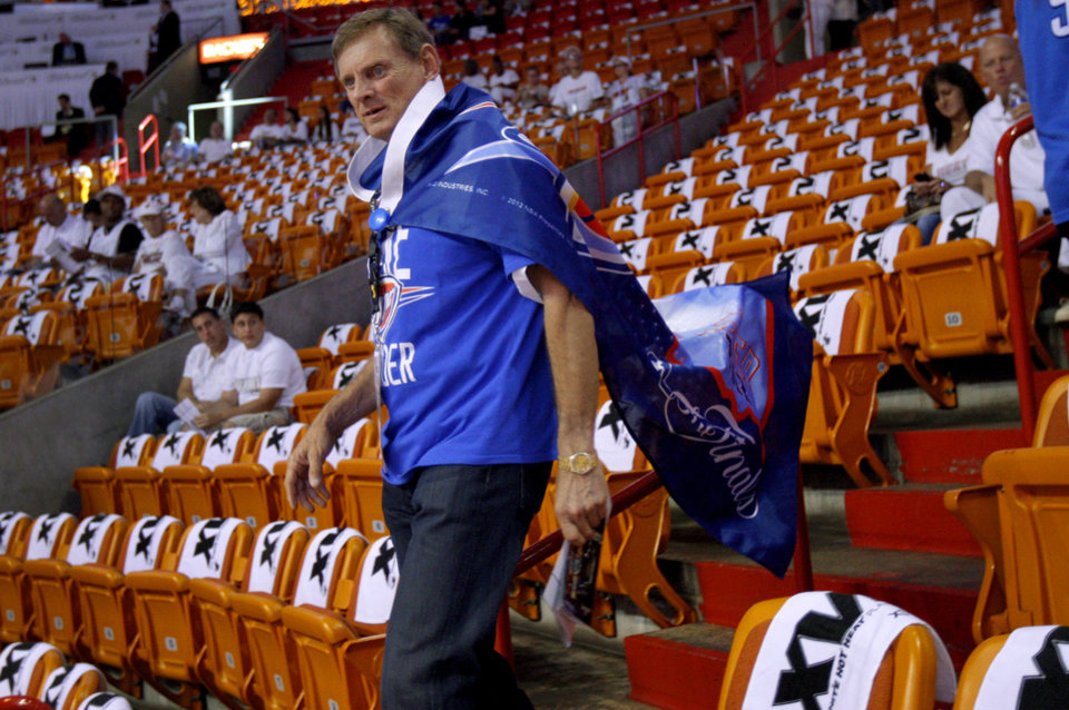 Photo - Jim Cavanaugh of Dallas, originally from Oklahoma City, finds his seat prior to Game 5 of the NBA Finals between the Oklahoma City Thunder and the Miami Heat at American Airlines Arena, Thursday, June 21, 2012. Photo by Bryan Terry, The Oklahoman