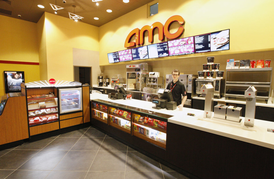 Kenneth Thacker, AMC Theatre senior manager, stands at the remodeled concession counter in the AMC theater at Penn Square Mall. <strong>PAUL B. SOUTHERLAND - PAUL B. SOUTHERLAND</strong>