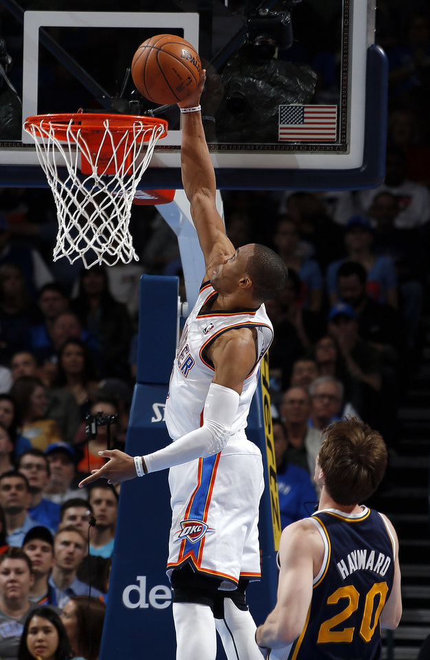 Oklahoma City's Russell Westbrook (0) dunks in front of Utah's Gordon Hayward (20) during the NBA game between the Oklahoma City and the Utah Jazz and the Chesapeake Energy Arena, Friday,Nov. 30, 2012. Photo by Sarah Phipps, The Oklahoman
