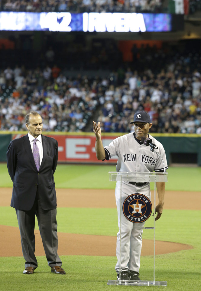 Photo - New York Yankees relief pitcher Mariano Rivera, right, acknowledges his teammates as former Yankees manager Joe Torre looks on during a ceremony to honor Rivera on his 18-year career in baseball before the game against the Houston Astros Sunday, Sept. 29, 2013, in Houston. (AP Photo/Richard Carson)