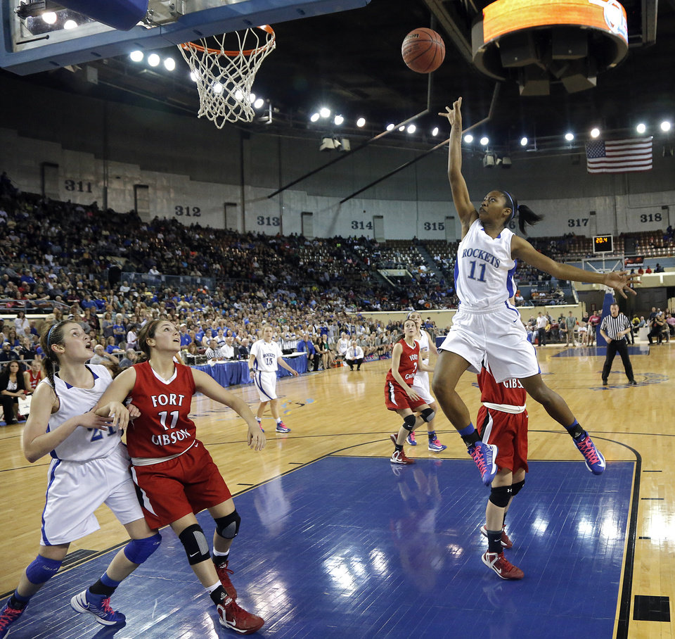 Mount Saint Mary's Adrienne Berry (11) drives to the basket during the state high school basketball tournament Class 4A girls championship game between Fort Gibson High School and Mount St. Mary High School at the State Fair Arena on Saturday, March 9, 2013, in Oklahoma City, Okla. Photo by Chris Landsberger, The Oklahoman