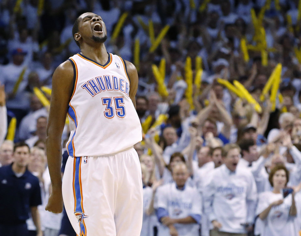 Photo -  Oklahoma City Thunder forward Kevin Durant (35) reacts after a dunk late in the fourth quarter of Game 2 of an opening-round NBA basketball playoff series against the Memphis Grizzlies in Oklahoma City, Monday, April 21, 2014. Memphis won 111-105 in overtime. (AP Photo/Sue Ogrocki)