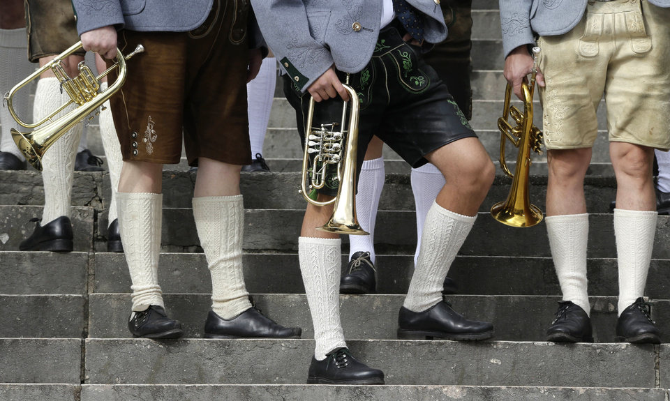Photo -   Musicians of the Oktoberfest orchestra arrive for the famous Oktoberfest beer festival concert in Munich, southern Germany, Sunday, Sept. 30, 2012. The world's largest beer festival, to be held from Sept. 22 to Oct. 7, 2012 will see some million visitors. (AP Photo/Matthias Schrader)