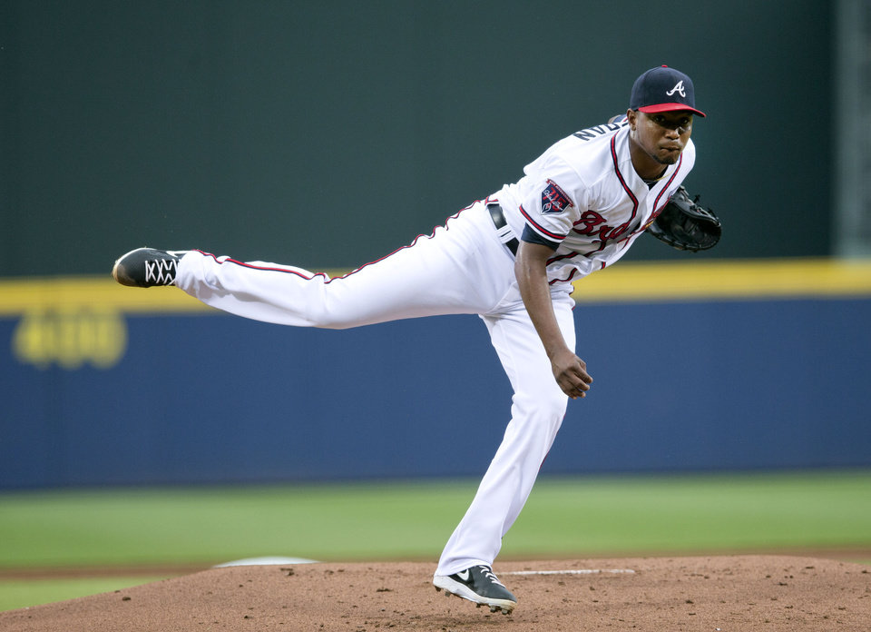 Photo - Atlanta Braves starting pitcher Julio Teheran (49) works against the Los Angeles Dodgers in the first inning of a baseball game  Monday, Aug. 11, 2014, in Atlanta.  (AP Photo/John Bazemore)